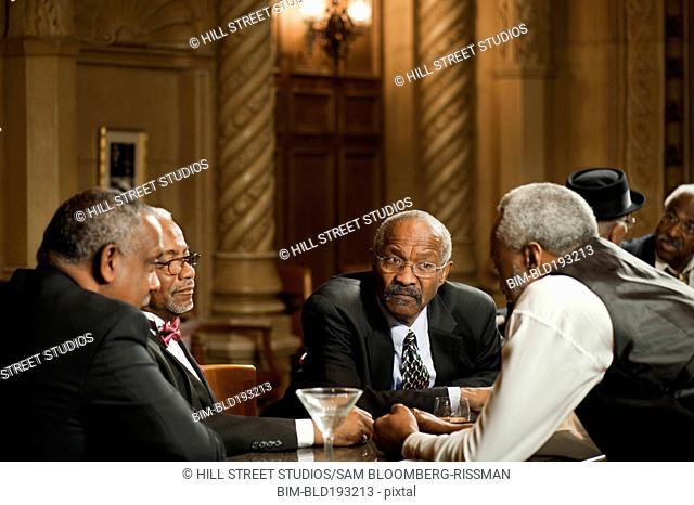 African American men drinking in bar