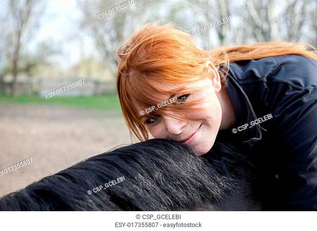 Young Beautiful Woman with Horse