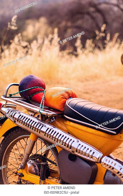 Motorbike with sleeping bag tied on, close-up