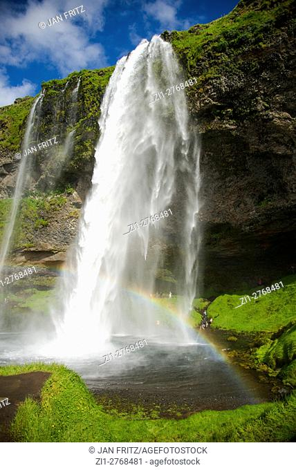 Seljalandfoss waterfall with rainbow at Iceland