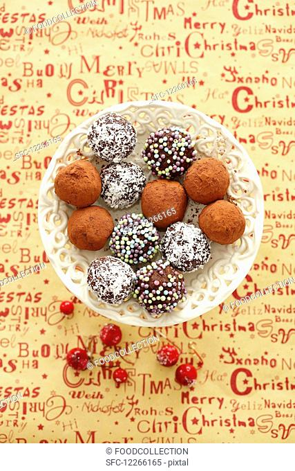 Chocolate truffles with coconut shavings, cocoa powder and sugar beads