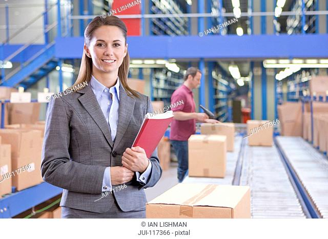Portrait Of Businesswoman In Warehouse Despatch Area