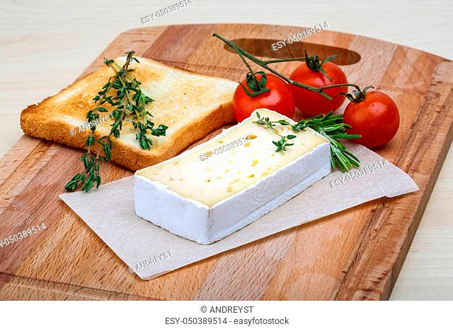 Soft brie cheese with rosemary, thyme and toast bread