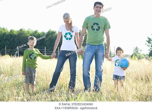 family walking on meadow