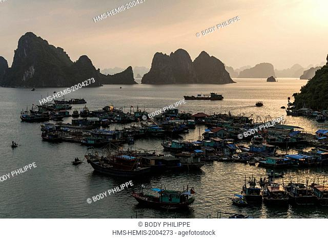 Vietnam, Quang Ninh province, Ha Long bay, listed as World Heritage by UNESCO, fishing boats in the port of Cai Rong