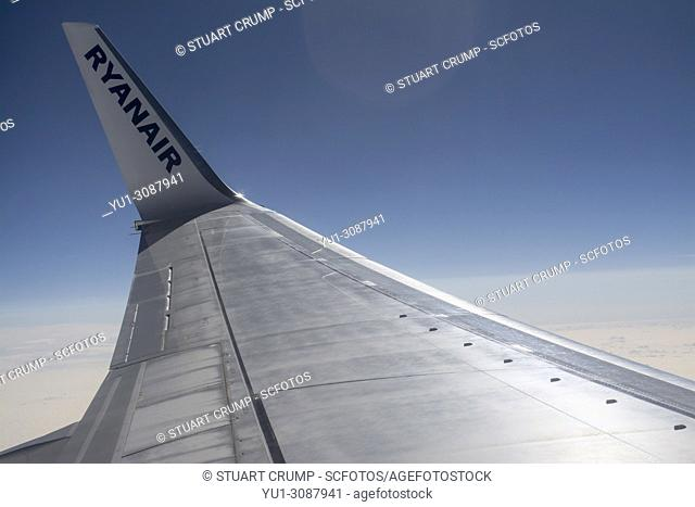 Airplane wing of a Ryanair Boeing 737-800 aircraft