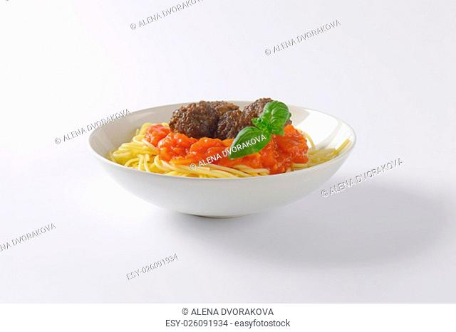 plate of spaghetti and meatballs in tomato sauce