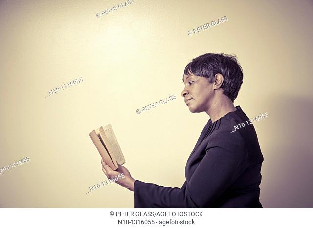 Middle-age black woman reading a book