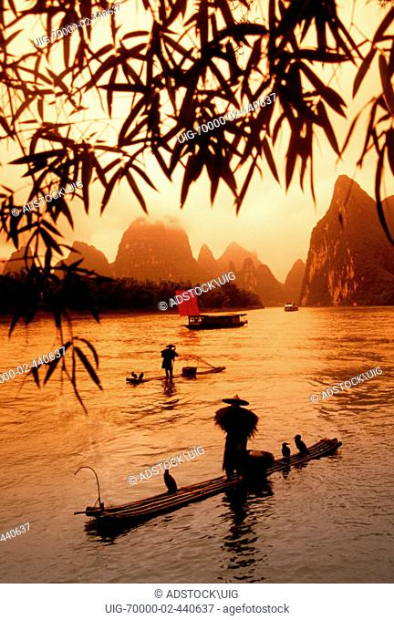Li River cormorant fishermen on bamboo rafts near Xingping in Guangxi China near Guilin