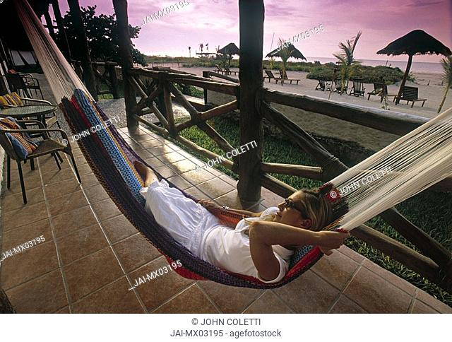 Woman in hammock, olbox Island, Cancun, Yucatan, Mexico