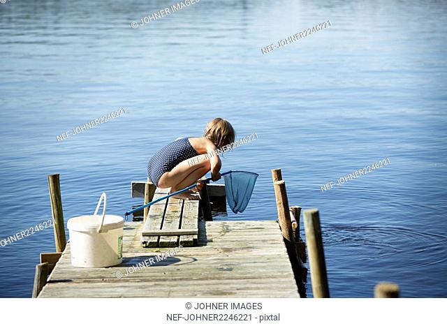 Girl fishing on jetty