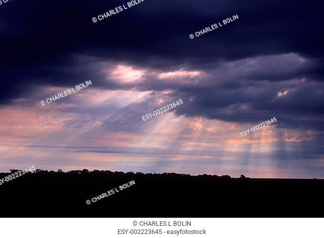 Rays of light break through morning storm clouds, Lancaster County, Nebraska, USA