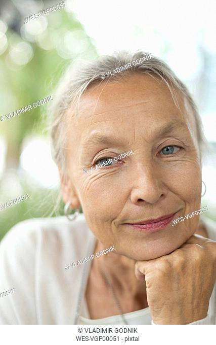 Portrait of confident senior woman outdoors