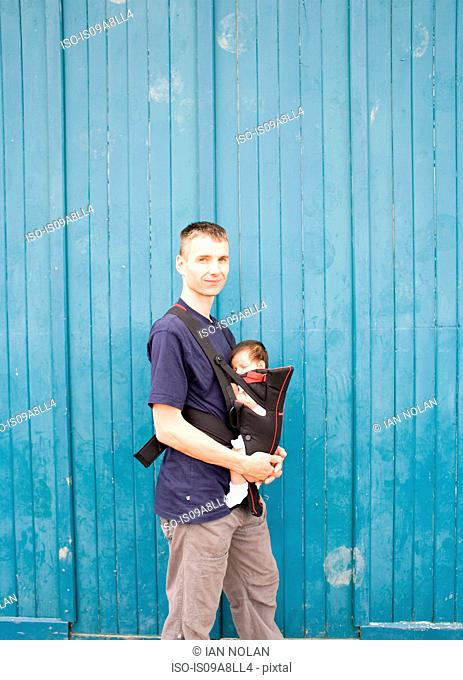 Father and baby boy in baby carrier