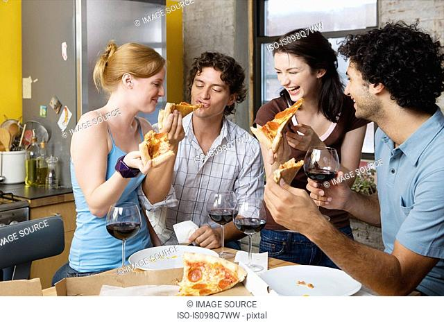 Friends sharing pizza at home