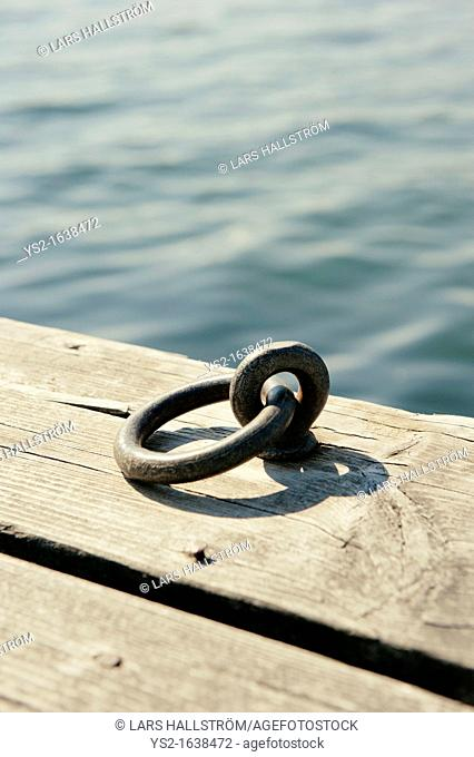 Close up of iron ring on jetty