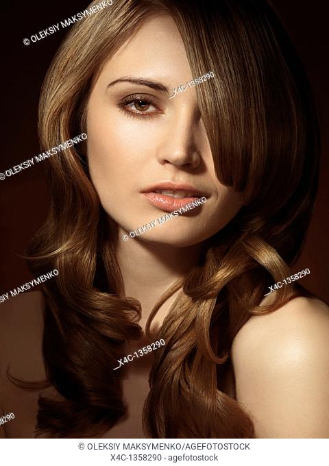 Portrait of a beautiful young woman with a trendy glamorous hairstyle