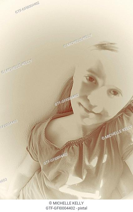 Monochrome Solarized portrait of little girl looking at camera