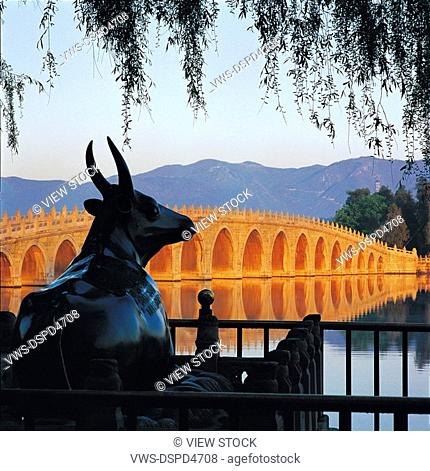 Bronze Cattle and seventeen-arch bridge at Summer Palace,Beijing