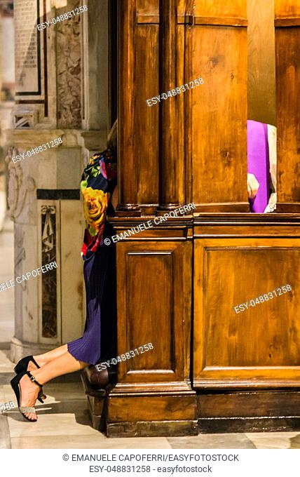 woman in confession in catholic church