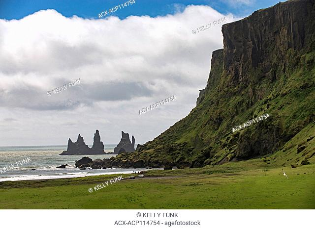 Reynisdrangar, basalt sea stacks situated under the mountain Reynisfjall near the village Vík in southern Iceland, Europe