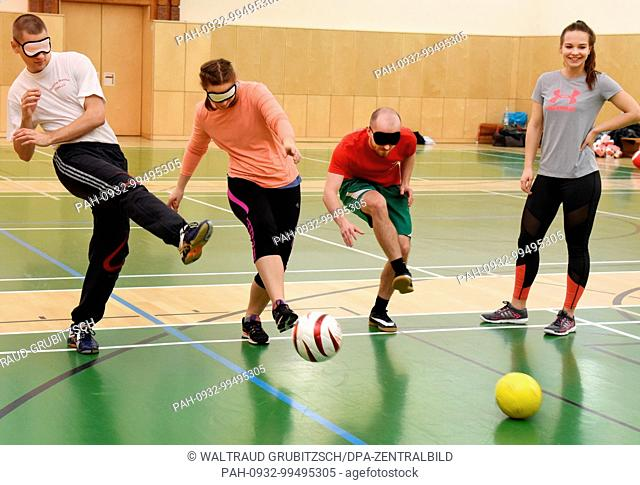 Trainee teachers in their 7th - 9th semesters, from the Faculty of Sport Science at Leipzig University try to play football blindfolded using a ball containing...
