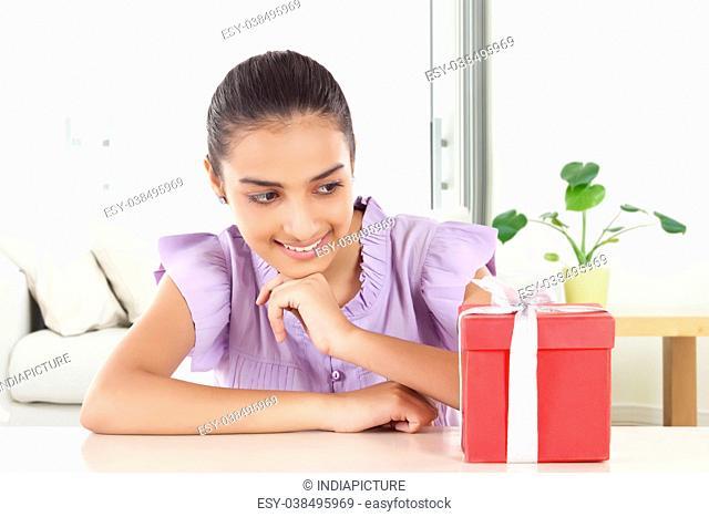 Happy Teenage Girls with gift