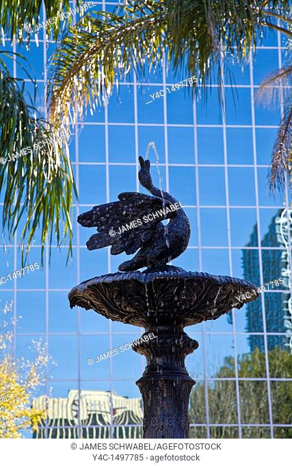 Fountain aganist glass modern building in downtown Orlando Florida