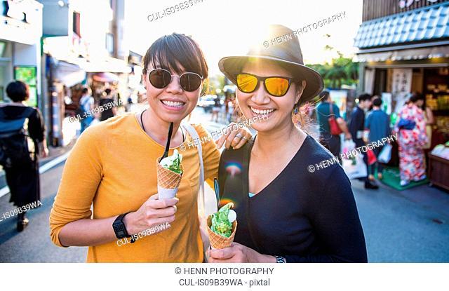 Friends eating green tea ice cream in Kyoto, Japan