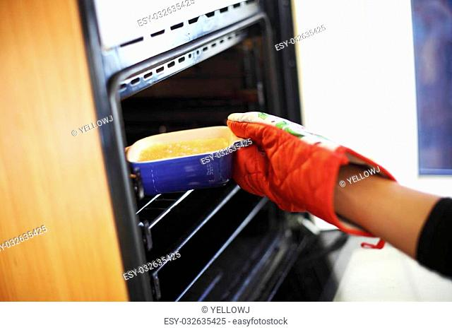 woman hand in gloves try to bake creme brulee