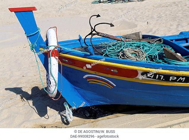 Painted bow of a fishing boat docked on the beach, Armacao de Pera, Algarve, Portugal