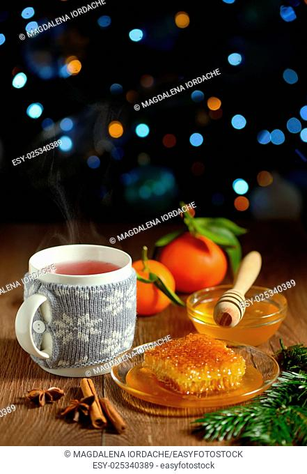 cup of hot tea with honey and winter spices