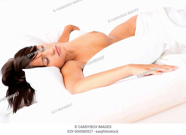 Naked brown hair woman sleeping in white bed