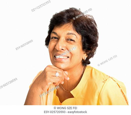 Portrait of a happy 50s Indian mature woman smiling, isolated on white background