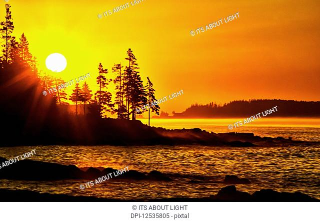Bright sunrise along the coast of Port Clyde; Cushing, Maine, United States of America
