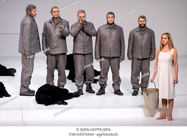 Opera singers Thomas Hampson (l) as Roald Amundsen, Mojca Erdmann (r) as Landlady and members of the ensemble perform on stage during a rehearsal of the opera...