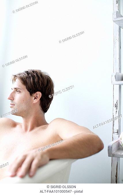 Man relaxing in bath