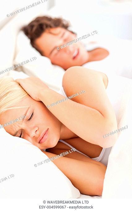 Portrait of a woman awaken by her boyfriend's snoring