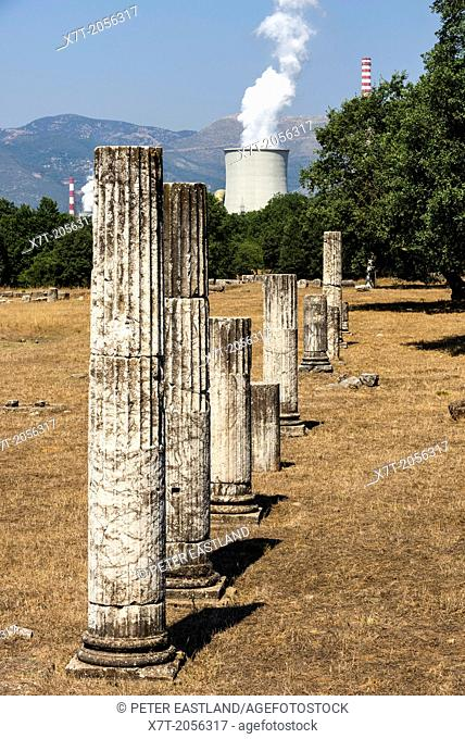 Columns from the ruins of Ancient Megalopolis with the cooling tower and chimney of Mergalopoli's modern power station in the background