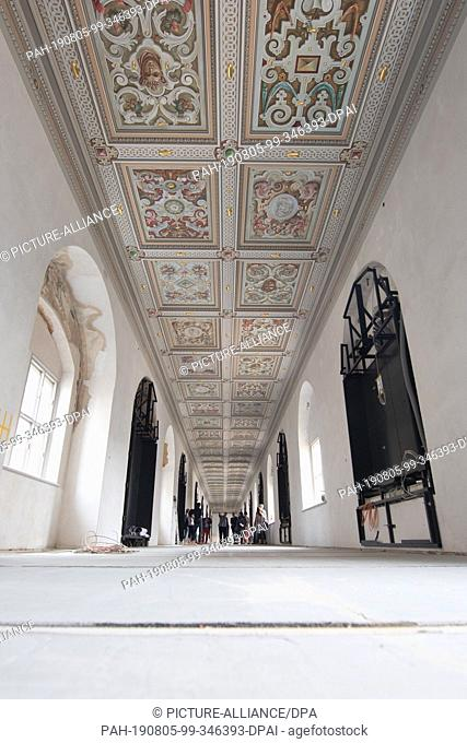 05 August 2019, Saxony, Dresden: Journalists go on a construction site tour through the Lange Gang, a historical link to the once royal riding stable in...