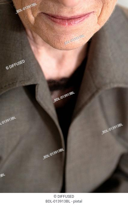 close-up on chin of elderly executive