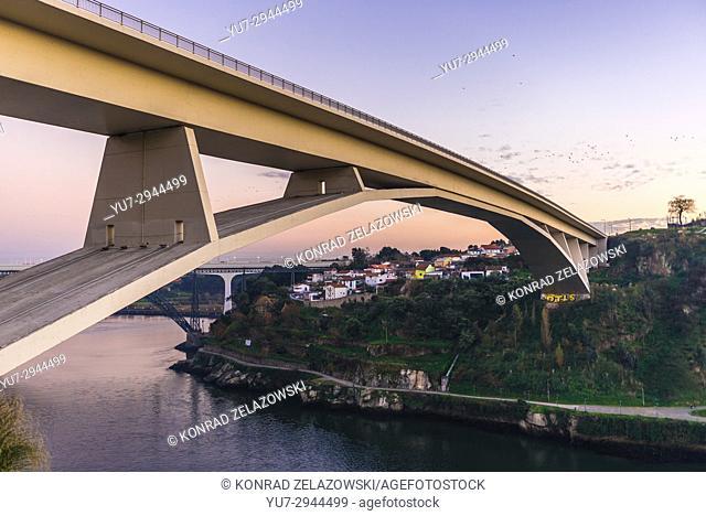 Infante D. Henrique Bridge over Douro River between Porto and Vila Nova de Gaia cities, Portugal. Old and new railway bridges seen on background