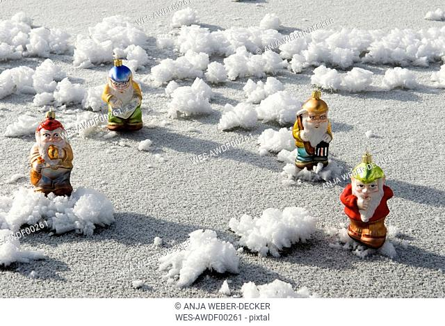 Christmas tree decorations, Garden gnomes standing on frozen lake