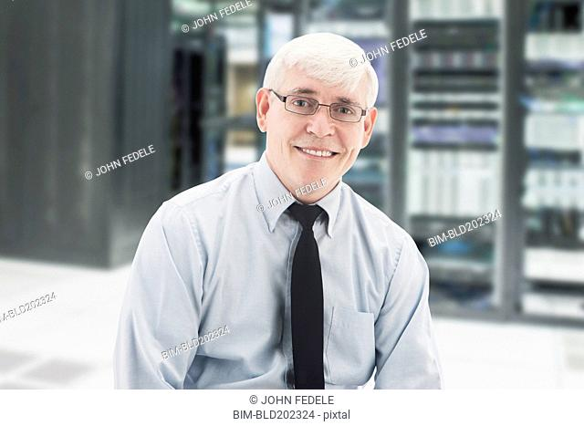 Caucasian businessman in server room
