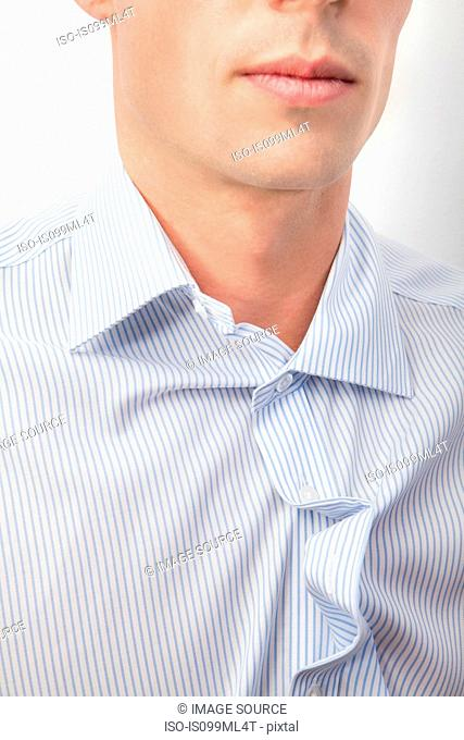 Young man with messy shirt