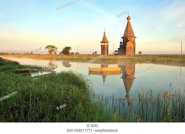 Ancient wooden church (1665) in Saunino village near Kargopol at sunrise, Russia