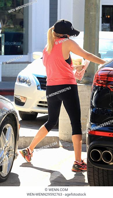 Reese Witherspoon has her hands fulls as she leaves the gym while chatting on her cell phone Featuring: Reese Witherspoon Where: Pacifc Palisades, California
