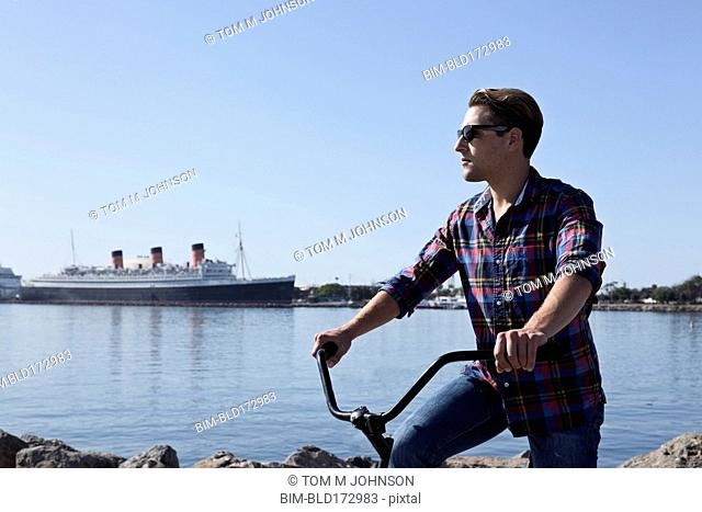 Man riding bicycle at waterfront