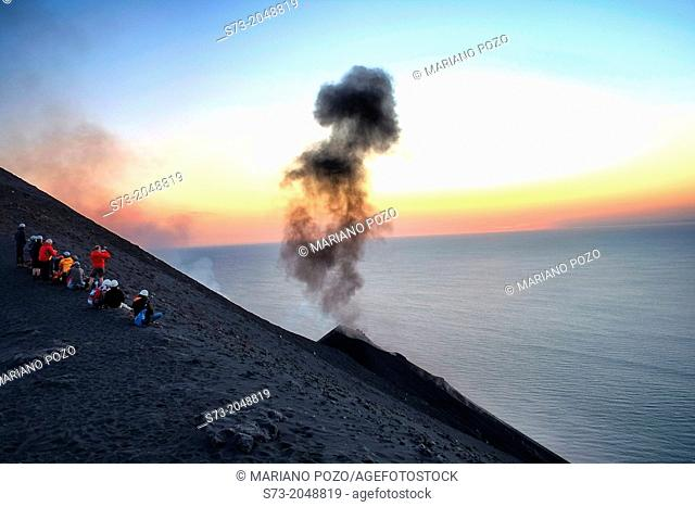 People looking Stromboli volcano eruptions, Sicily, Italy