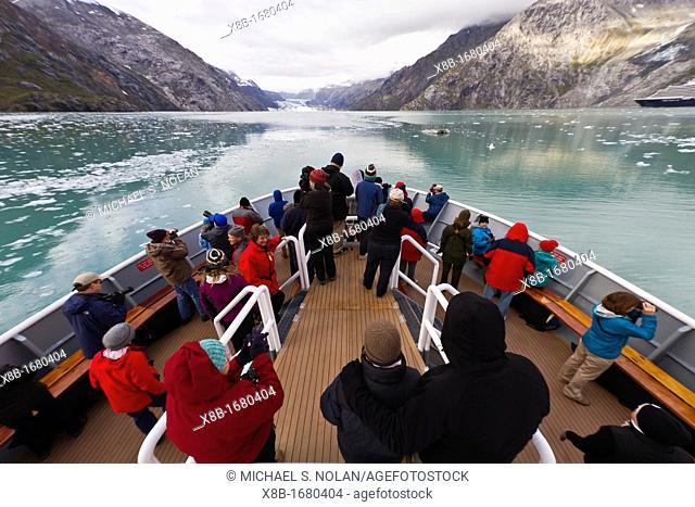 Guests from the Lindblad Expeditions ship National Geographic Sea Bird in Glacier Bay National Park, Southeast Alaska, USA